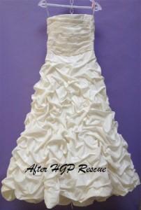 Damaged wedding dress after treatment
