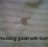 Burn Hole Repair Needed For Wedding Gown Restoration