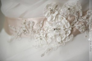 A rum pink appliqué belt by Gisele Bridal made the gown perfect.
