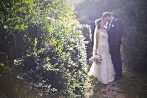 In the woods - Jennifer and husband for wedding dress story