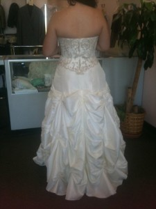 Ashley tries on her wedding dress for the first time.