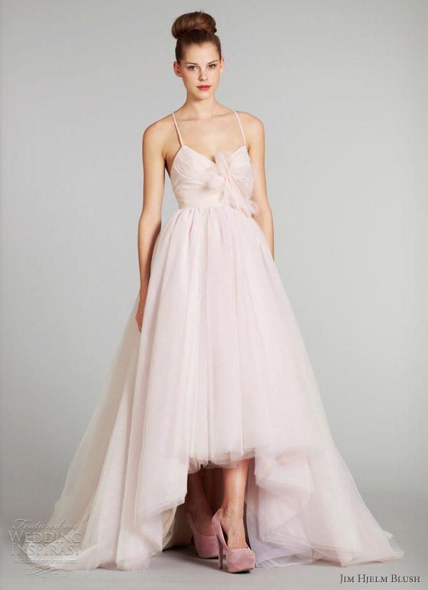 "Wedding gown by <a href=""http://www.jlmcouture.com/Jim-Hjelm"">Jim Hjelm</a>"