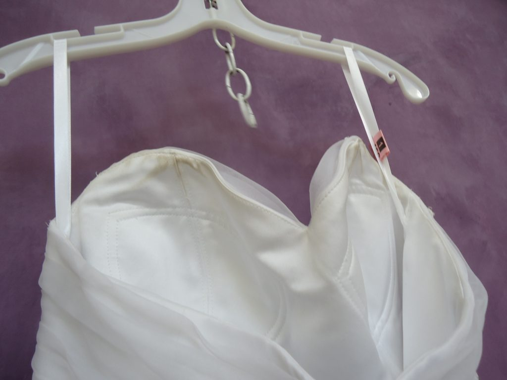Makeup and sweat stains on inside of bodice and near armpits.