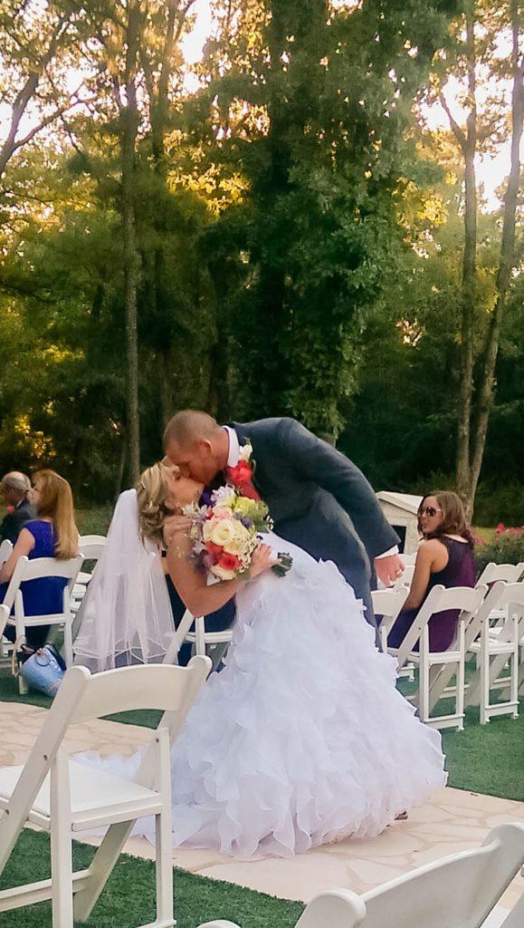 Wedding dress preservation bride and groom kissing