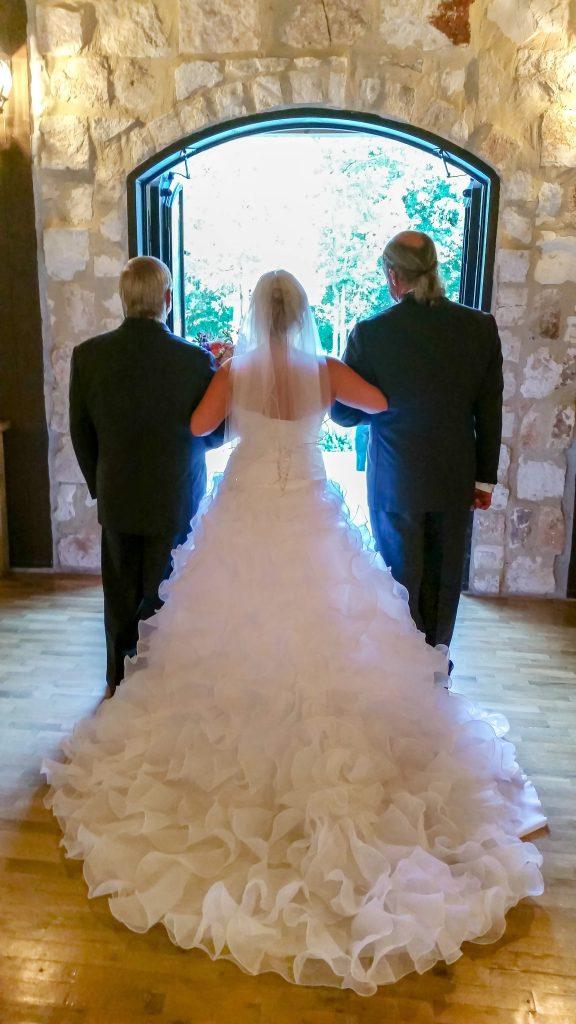 wedding dress cleaning customer walks down the aisle