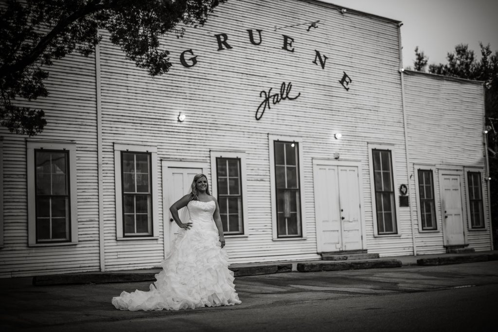 Fun black and white bridal photo of wedding dress preservation customer