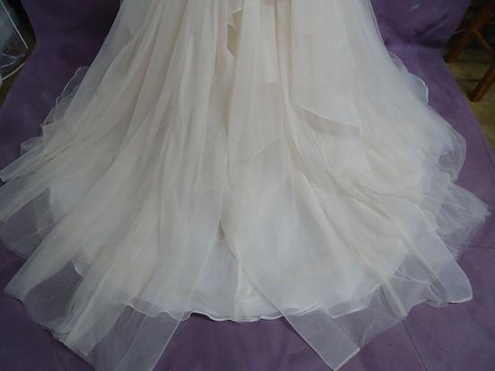 HGP's expert wedding dress cleaning removed the sand in Stephanie's wedding dress hemline.