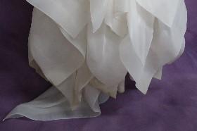 Kyle's messy wedding dress hemline before wedding dress cleaning.