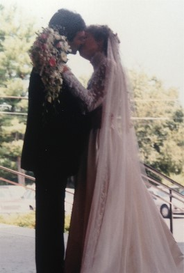 Karen and husband seal the deal with a kiss on her wedding in 1985.