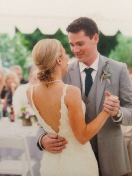 Catie and husband dance at their wedding. Wedding dress preservation will allow future generations to wear their heirloom gown.