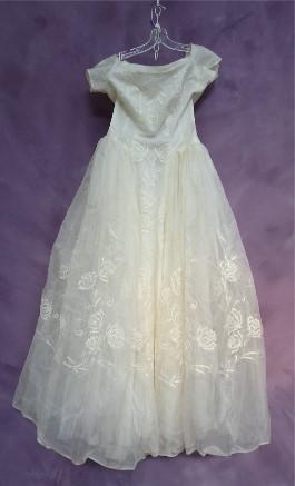 Abigail's Grandmother's wedding gown before wedding dress restoration.