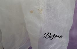 Oxidized spots on Abigail's grandmother's wedding dress before wedding gown restoration.