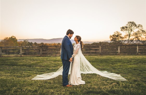 A stunning outdoor photo session left Mackenzie's hemline dirty. Our expert wedding dress cleaning made it pristine again.