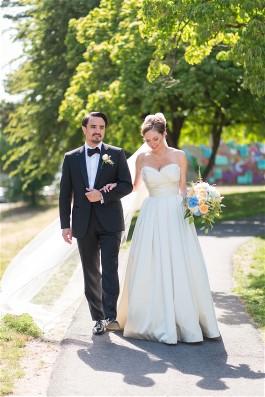 Katherine Grant wears Luly Yang silk wedding dress. Wedding dress preservation ensures her wedding gown and heirloom headpiece can be worn again.