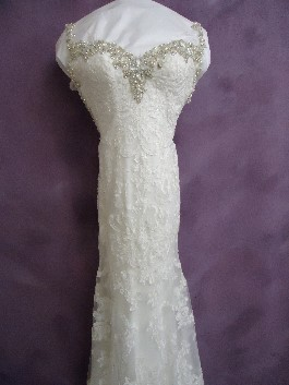 The front of Emily's wedding dress after wedding dress cleaning and Museum Method wedding dress preservation.