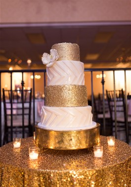 Gen's wedding cake sparkles. Expert wedding dress cleaning can get messy cake out of gowns.