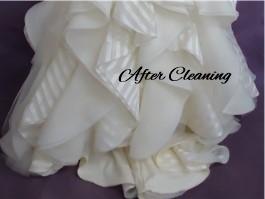 Gen's wedding gown hemline after thorough wedding dress cleaning.
