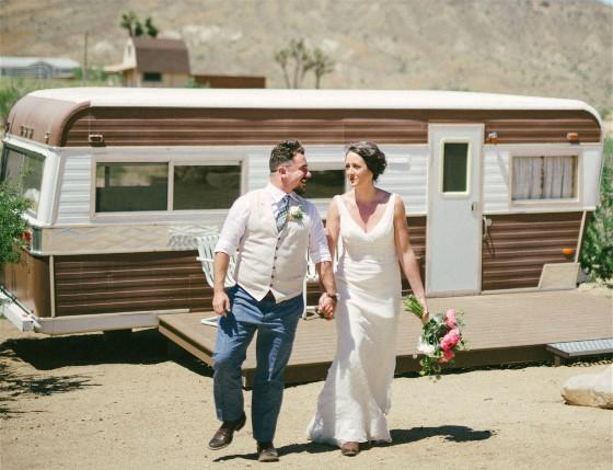 A desert wedding is beautiful but leaves desert dirt behind, needing wedding dress cleaning.