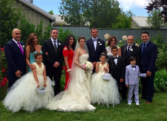 Laurel's Bridal Party with adorable flower girls in ruffled gown similar to the bride.