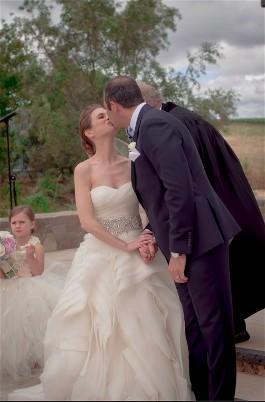 Laurel and groom kiss on wedding day.