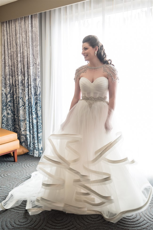 Coti's Pnina Tornai wedding dress was exquisite with silk ribbon trimmed ruffles.