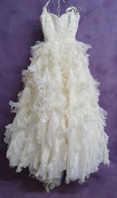 Lauren's friend's Oscar de la Renta wedding dress before expert cleaning.