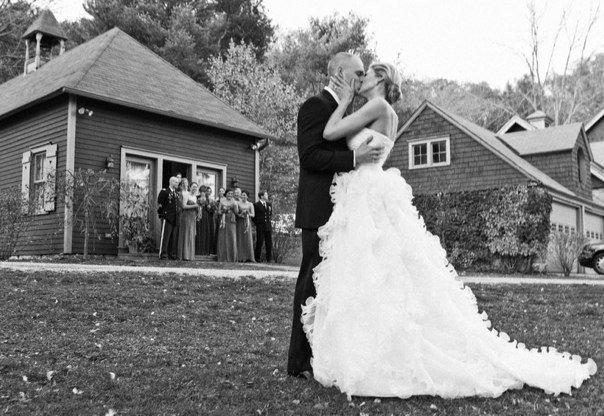 Silhouette of Oscar de la Renta wedding dress shows the unique style of ruffled gown.
