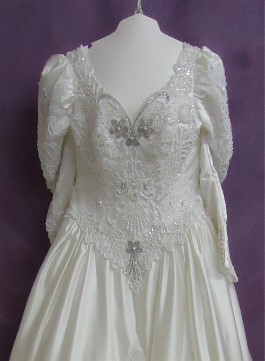 Margaret's wedding dress after wedding dress restoration. It has been whitened and the beads look much better.