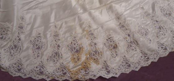 Margaret's wedding gown train before wedding dress restoration with oxidized stains.