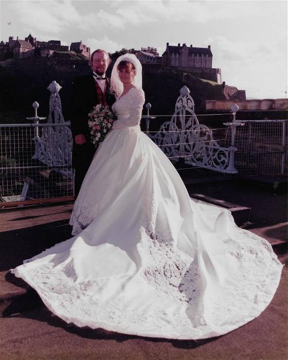Margaret and new husband enjoy beautiful Scottish castle background on their wedding day.