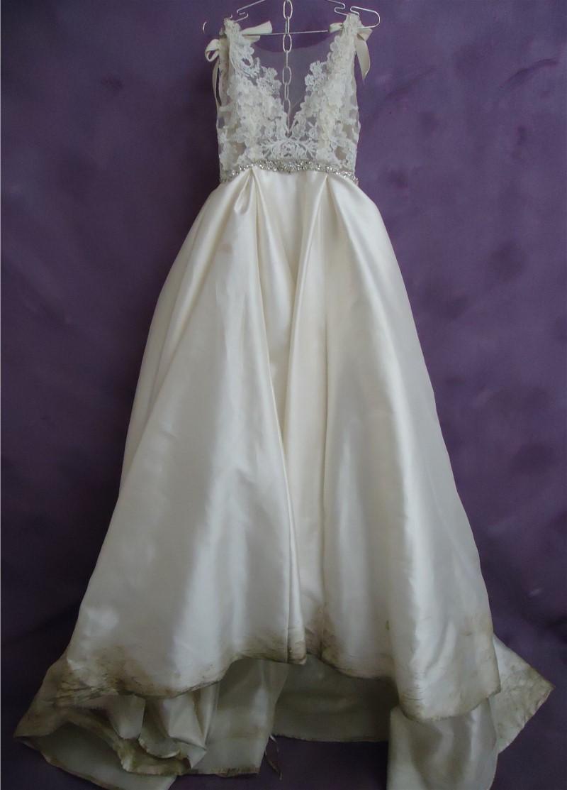 Kelsey's wedding dress before HGP's expert wedding dress cleaning.