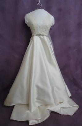 Kelsey's wedding dress AFTER expert wedding dress cleaning.