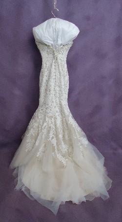 Jamie's gown back after wedding dress preservation.