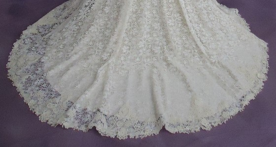 HGP gave expert wedding dress cleaning and Museum Method wedding dress preservation to Sarah's gown. Her hemline is as good as new.