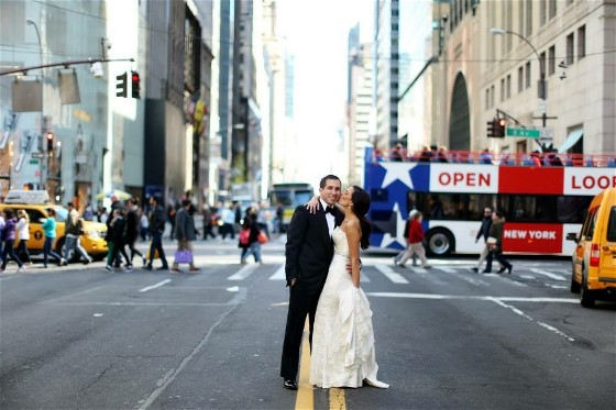 Nikki and Jason enjoy a city romp on their wedding day. Wedding dress cleaning and wedding dress preservation will return the gown to a beautiful condition.