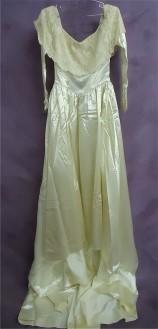 Amy's heirloom gown before wedding dress restoration.