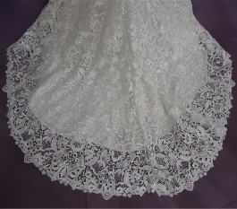 HGP's expert wedding dress cleaning returned hemline to pristine condition.