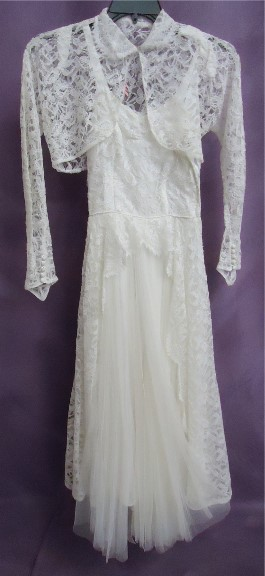 Joyce's vintage wedding dress After wedding dress restoration.