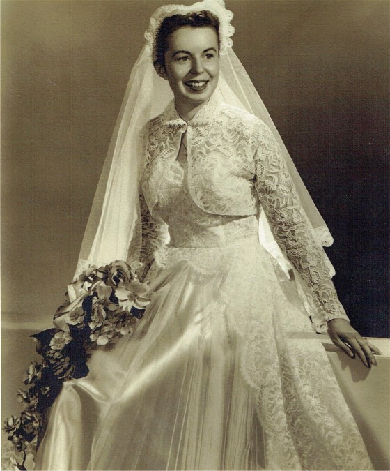 Joyce is married in lace and satin wedding dress in 1955.