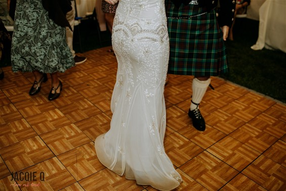 Dancing during wedding celebration after a wet wedding meant a very dirty hemline.   HGP's expert wedding dress cleaning and museum quality wedding dress preservation restored Rebeccah's wedding gown to a beautiful condition.