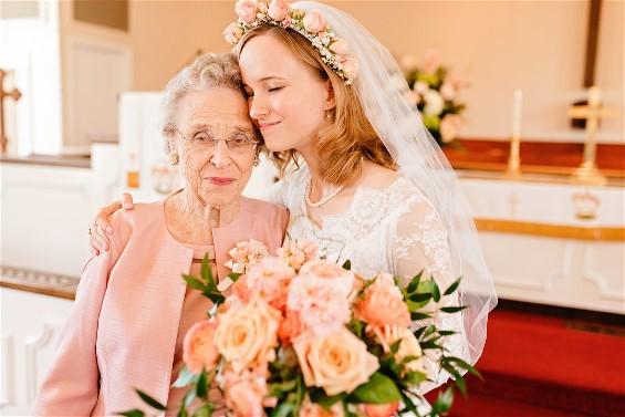Ellen with her grandmother Jeweldine on her wedding day. Ellen is wearing her grandmother's wedding gown after wedding dress restoration.