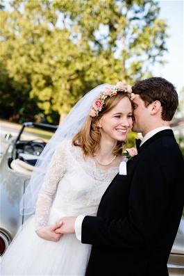 Ellen and husband on wedding day. Ellen wears grandmother's gown after wedding dress restoration.