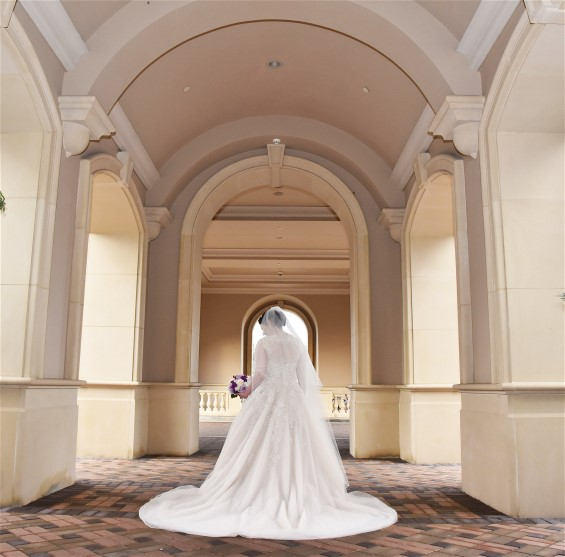 Stunning back view of Ilyse on her wedding day. Wedding dress preservation will keep her gown in beautiful condition.