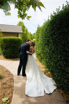 Melissa and new husband on wedding day. Wedding dress preservation will keep her wedding dress beautiful for years to come.