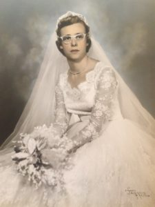 Ellen's grandmother on wedding day. Wedding dress restoration restored this gown so it could be worn again.