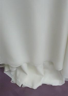Jenny's wedding dress hemline AFTER wedding dress cleaning.