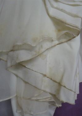 Jenny's wedding dress hemline BEFORE wedding dress cleaning.