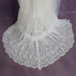Closeup of Kelsey's hemline AFTER wedding dress cleaning.