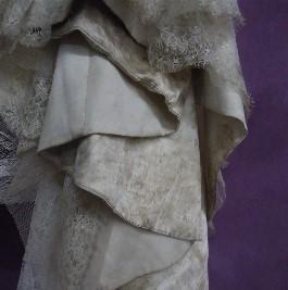 Closeup of Kelsey's hemline BEFORE wedding dress cleaning.