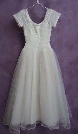 Irene's wedding gown after wedding dress restoration.